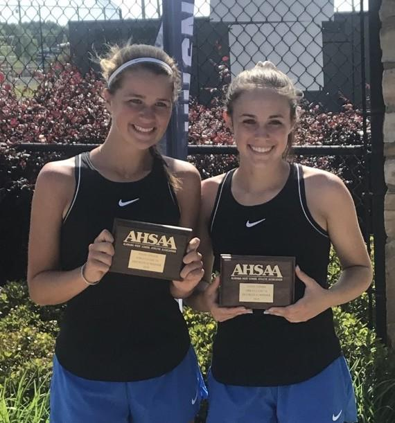 Two female students standing side-by-side holding their AHSAA plaques